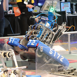 An FRC Robot crossing the field during game play.