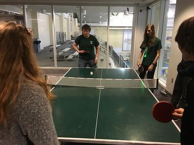 Teams playing table tennis.