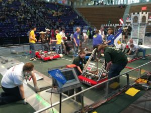 teams placing their robots onto the field for a match.