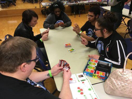 Teams playing board games.