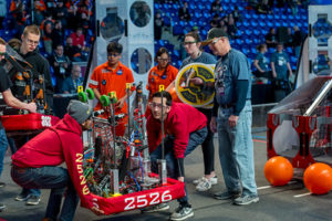 A team placing their robot on the field for a match.