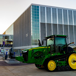 A John Deere Tractor and UNI Panther welcome teams to the Iowa Regional.