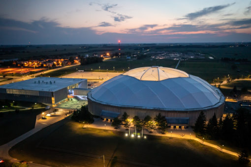 Evening overhead view of the University of Northern Iowa Dome and McLeod Center.