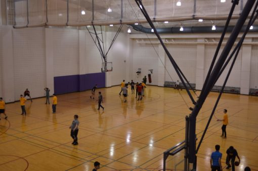 Open Gym with teams playing basketball.